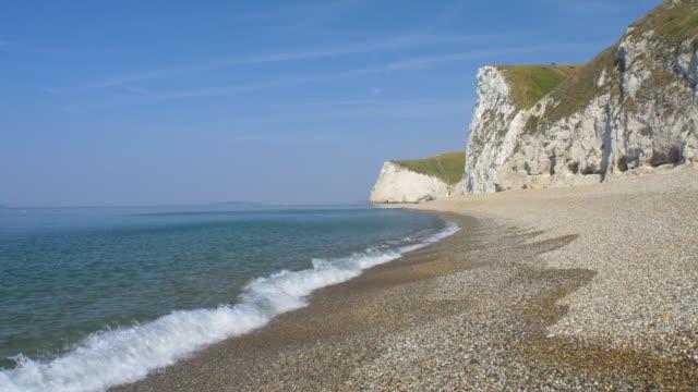 beach at durdle door.jurassic coast. dorset, england. - jurassic stock videos & royalty-free footage