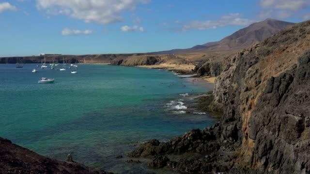 beach at playa del pozo, playas de papagayo, lanzarote, canary islands, spain, atlantic, europe - atlantic islands stock videos & royalty-free footage
