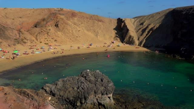 beach at playas de papagayo, lanzarote, canary islands, spain, atlantic, europe - atlantic islands stock videos & royalty-free footage