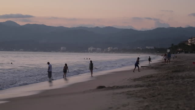 beach at sunset, nuevo vallarta, nayarit, puerto vallarta, mexico, north america - medium group of people stock videos & royalty-free footage