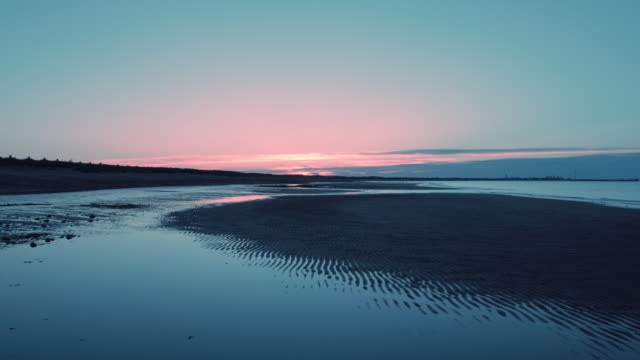 beach at sunset - northumberland video stock e b–roll