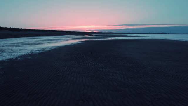 beach at sunset - low tide stock videos & royalty-free footage