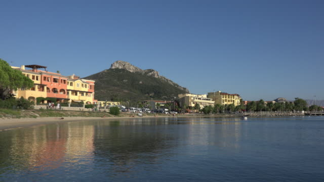 pan / beach at village of golfo aranci - sassari stock videos & royalty-free footage