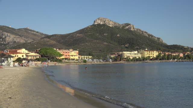 beach at village of golfo aranci - spiaggia stock videos & royalty-free footage