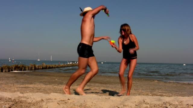 beach attack - squirt gun stock videos and b-roll footage