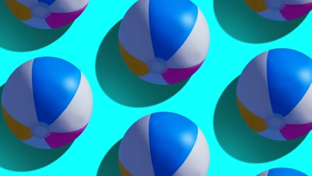 beach ball on blue background - scontornabile video stock e b–roll