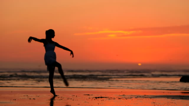 beach ballet at sunset - one teenage girl only stock videos & royalty-free footage