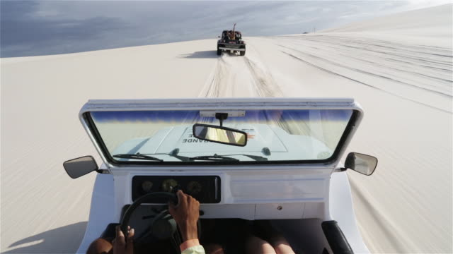 WS, POV Beach buggies speed across sand dunes / Natal, Brazil