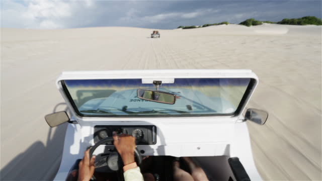ws, pov beach buggies speed across sand dunes / natal, brazil - dune buggy stock videos and b-roll footage