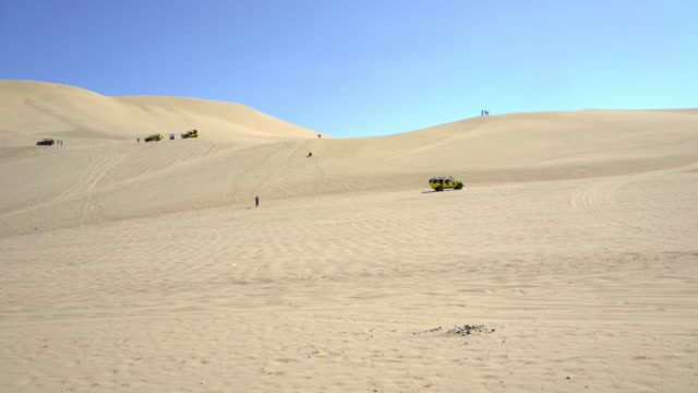 beach buggy drive on desert near huacachina oasis  peru - dune buggy stock videos and b-roll footage