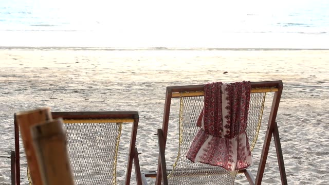 beach chair on the beach - outdoor chair stock videos and b-roll footage
