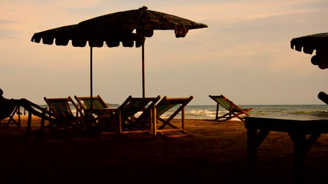 beach chairs and umbrella - beach umbrella stock videos and b-roll footage
