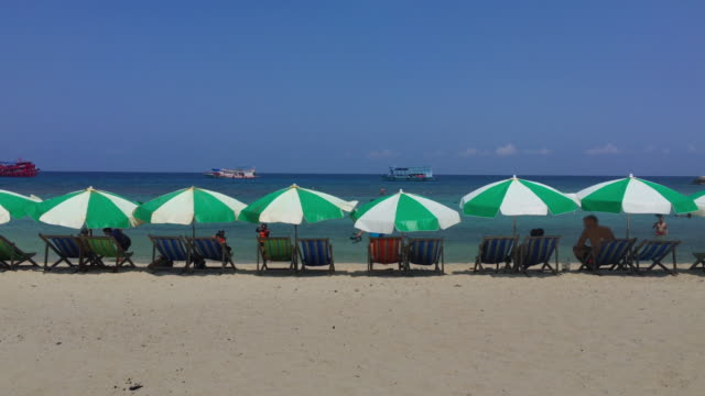 beach chairs at summer on paradise island - beach umbrella stock videos and b-roll footage