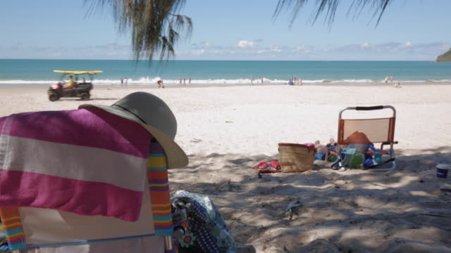 Beach chairs, hat, towel and other stuff at Noosa Beach, Queensland, Australia