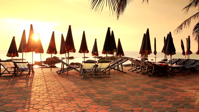 beach chairs in evening at sunset - deckchair stock videos & royalty-free footage