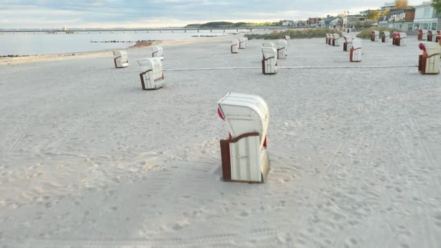 beach chairs stand on a deserted beach on the baltic sea coast during the novel coronavirus crisis on april 25, 2020 in groemitz, germany. while... - ostsee stock-videos und b-roll-filmmaterial