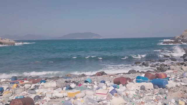 stockvideo's en b-roll-footage met beach covered in plastic and rubbish showing climate change issue in hong kong. aerial drone view - hong kong