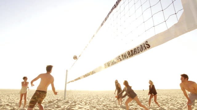 slow motion - beach friends group - volleyball sport stock videos and b-roll footage