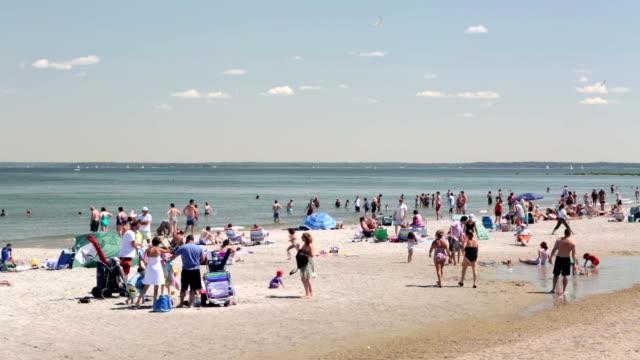 Beach goers enjoy a sunny day at a New England beach