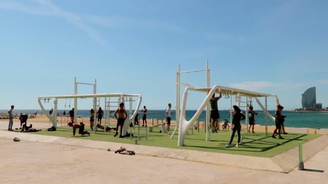 beach gym, barcelona, spain - body building stock videos & royalty-free footage