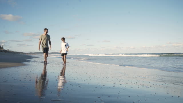 beach hangout with dad - hiking stock videos & royalty-free footage