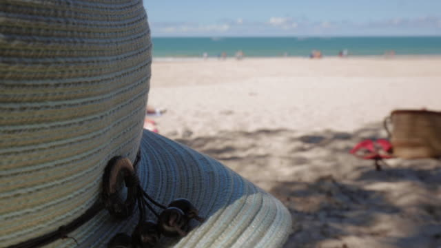 A beach hat and the Noosa Beach, Queensland, Australia
