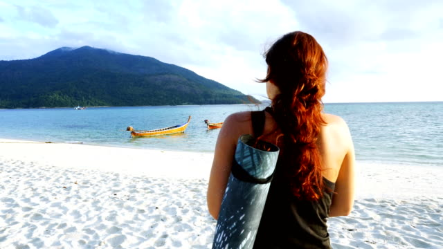 beach holiday. woman walking to the sea with yoga mat - turquoise coloured stock videos & royalty-free footage