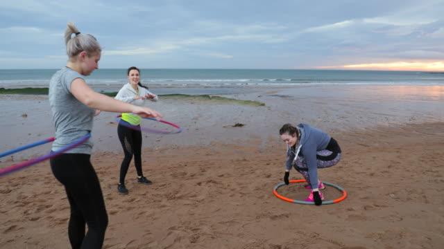 beach hula-hooping - plastic hoop stock videos & royalty-free footage
