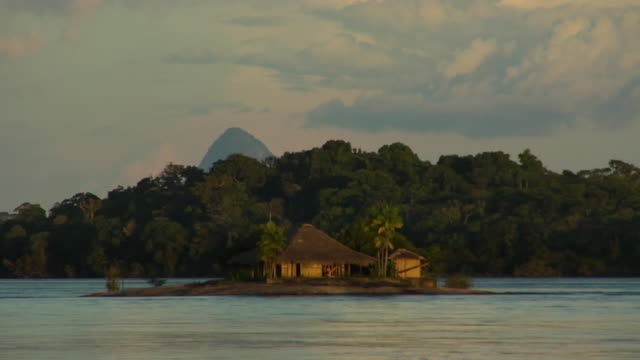 t/l ws pan beach hut on river negro small island at sunset / sao gabriel da cachoeira, amazonas, brazil - cachoeira stock videos and b-roll footage
