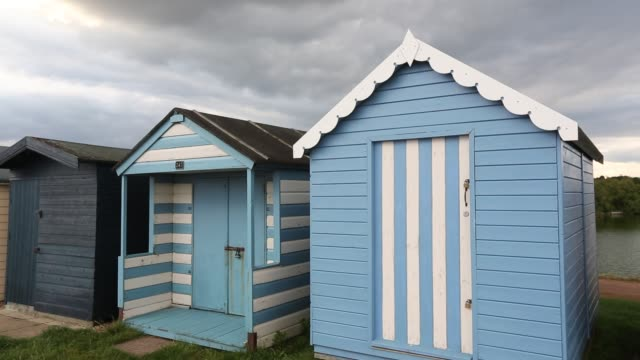 beach huts in brightlingsea, essex, uk on september 3, 2015. - multi coloured stock videos & royalty-free footage