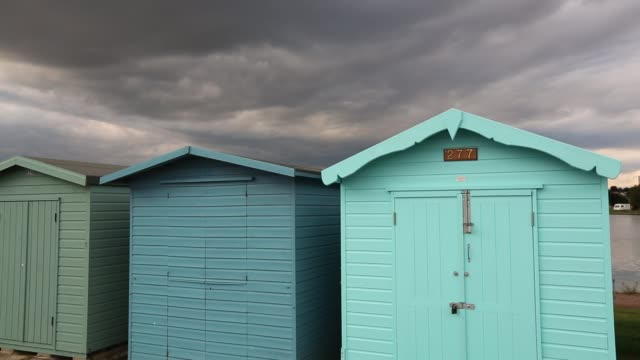 beach huts in brightlingsea, essex, united kingdom on september 3, 2015. - multi coloured stock videos & royalty-free footage