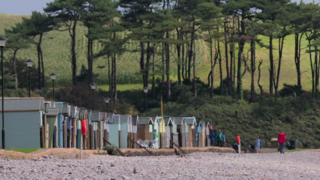 beach huts on a pebble beach, south west england - shack stock videos & royalty-free footage
