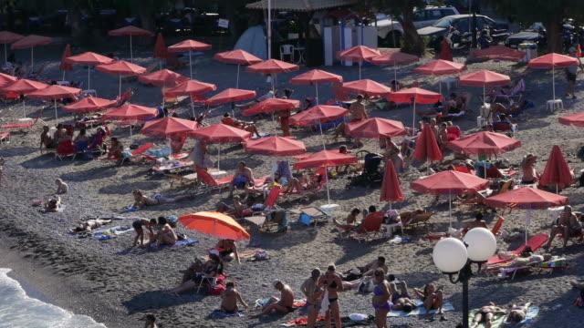 beach in agios nikolaos on crete, greece. - spoonfilm stock-videos und b-roll-filmmaterial