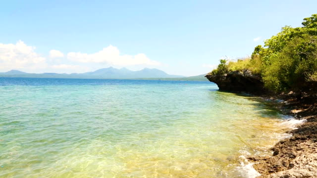 beach in north bali on a sunny day - north bali stock videos & royalty-free footage