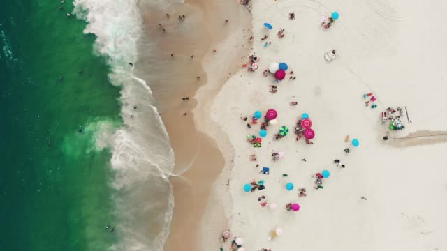 beach in rio de janeiro, brazil from above - parasol stock videos & royalty-free footage