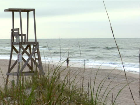 beach lifeguard chair - lifeguard chair stock videos & royalty-free footage
