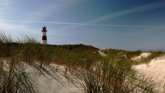 beach lighthouse in the dunes on the island of sylt - leuchtturm in list auf sylt - tina terras michael walter stock videos & royalty-free footage