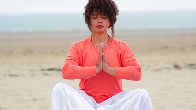 beach meditation - lotus position stock videos & royalty-free footage