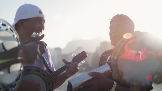 MS Beach musicians sing and play instruments on Ipanema beach / Rio de Janeiro, Brazil