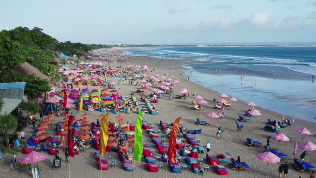 beach of seminyak in bali with bars and restaurants - tourist stock videos & royalty-free footage