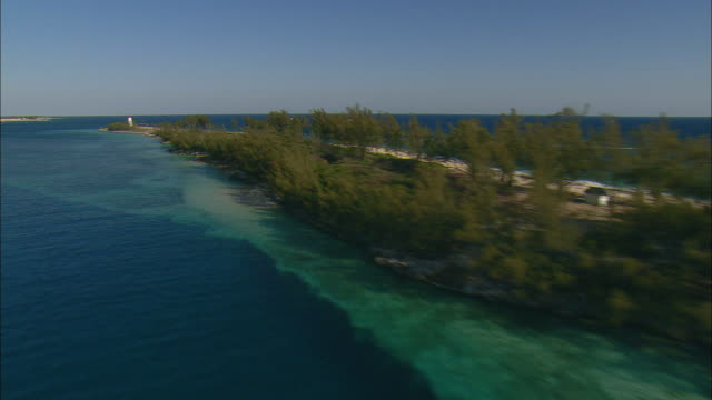 aerial beach on west end of paradise island and nassau lighthouse, bahamas - nassau stock videos & royalty-free footage