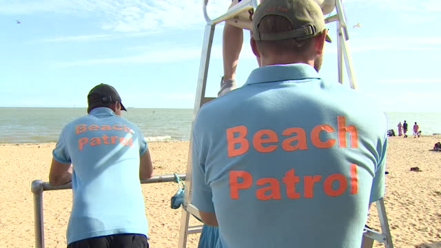 beach patrol lifeguards on clacton beach - vacations stock videos & royalty-free footage