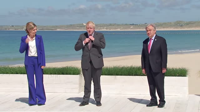 beach photocall with boris johnson pm, his wife carrie, and un secretary general antonio guterres, part of the extended g7 family, carbis bay - wife stock videos & royalty-free footage
