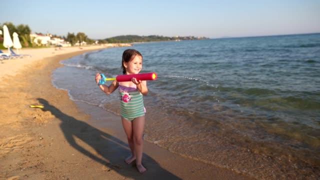 beach playfulness - water pistol stock videos & royalty-free footage