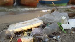 Beach polluted with plastic and plastic bottles