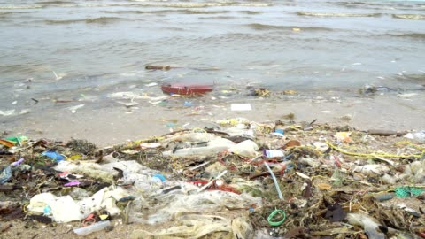 beach pollution. plastic bottles and other trash on sea beach - environmental issues stock videos & royalty-free footage