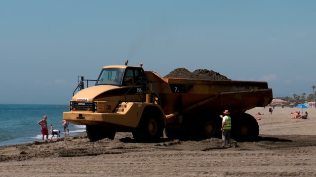 beach regeneration following winter storms - dump truck stock videos and b-roll footage