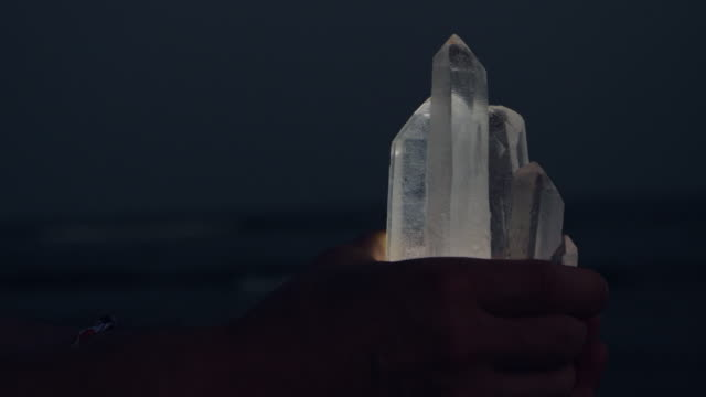 beach relaxation. holding healing crystals - mindfulness stock videos & royalty-free footage