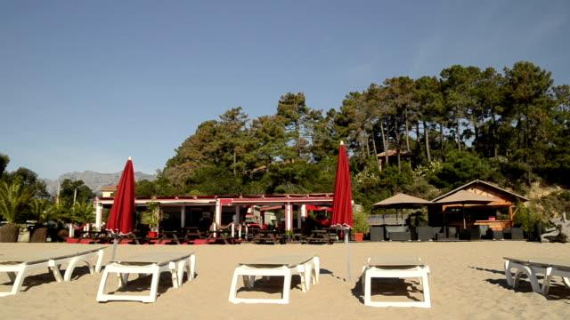 Beach Restaurant and sunshades at sandy beach