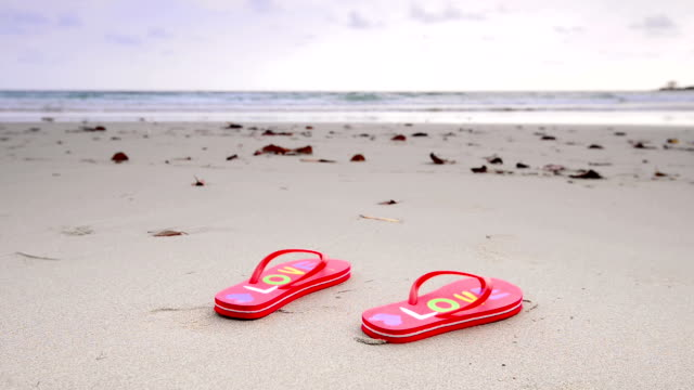 beach sandals - slipper stock videos and b-roll footage